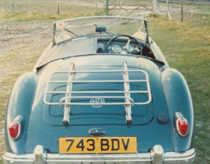 Photograph of the rear view of a blue classic MGA Roadster