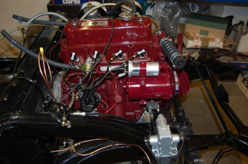 Engine now finished - electronic ignition module fitted in original Lucas distributor, new Lucas coil and Powerlite Dynalite. The Champion plug caps are not original fitment, but during my 41 years of ownership it always had them and I like the look. MGA 1500 engine.