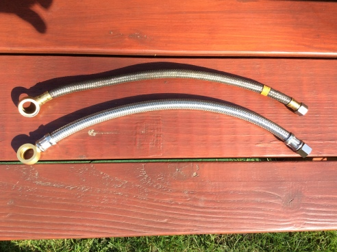 Carburettor feed pipes. The top one is the original Smiths pipe as supplied with the car when new. It wrankles that I can't risk re using it, due to the age of the rubber pipe inside the brading and also the damage modern fuels will do. The lower pipe is the Moss Europe supplied pipe which is a greater in diameter and much chunkier looking. Unfortunately. as far as I know, there is no other option available that is nearer to the original.
