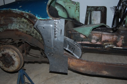 First new metal is cut to fit - Sportscar Metalworks repair panel required major reshaping to fit, particularly the repositioning of the chassis mounting bracket. See details in photos of left side restoration.
