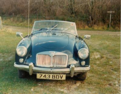 Photograph of the front of a blue MGA Roadster