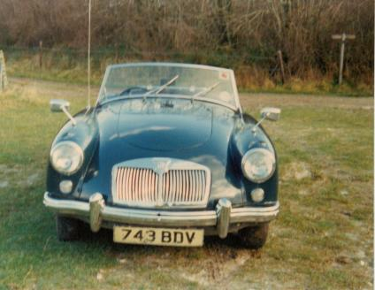 Photograph of a Classic blue MGA Roadster